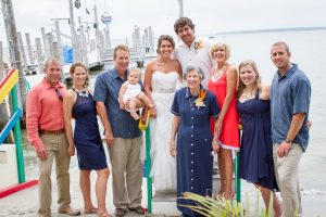 The bridal party poses for a photo on the beach at Seacrets in Ocean City, MD.