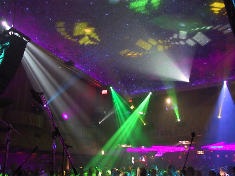 a nightclub with green and blue spotlights