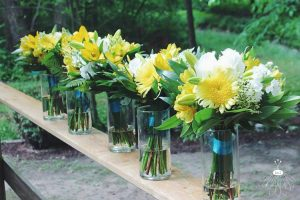 flowers sit in clear glass vases