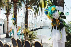 palm trees decorated with flowers and white bows