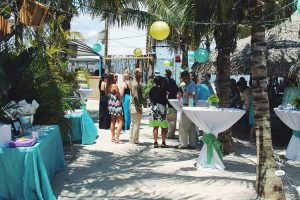 an outdoor banquet with teal and white tablecloths