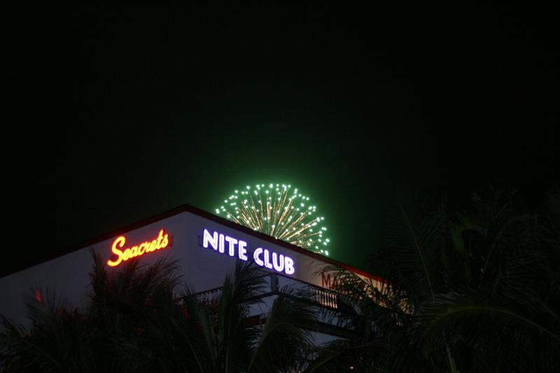 a nightclub with fireworks exploding over it