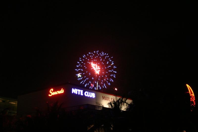 a firework explodes above a nightclub