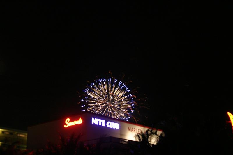 firework explosion over a nightclub sign