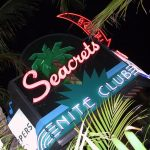 Seacrets nite club neon sign billboard