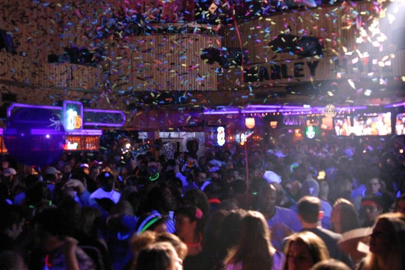 confetti falls into a crowd of nightclub goers
