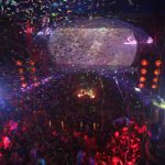 confetti steams down onto nightclub partiers