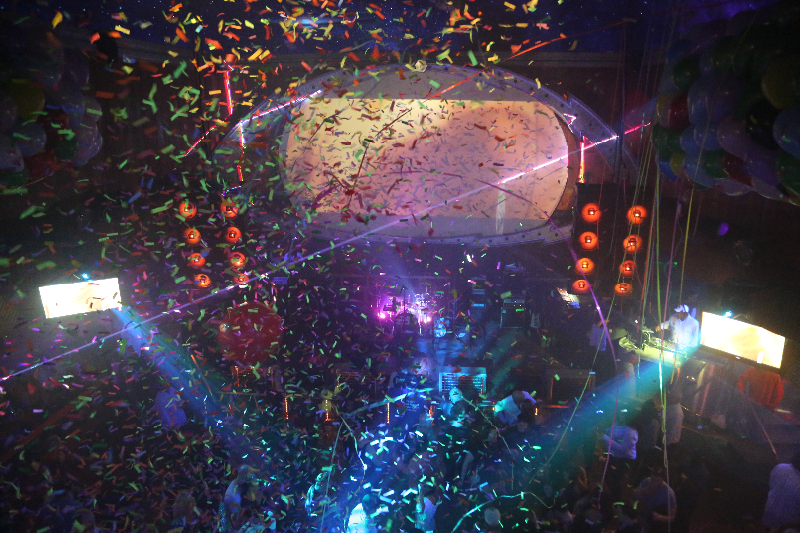 confetti falls onto a crowd at a nightclub