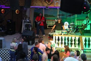 A band plays live for a crowd