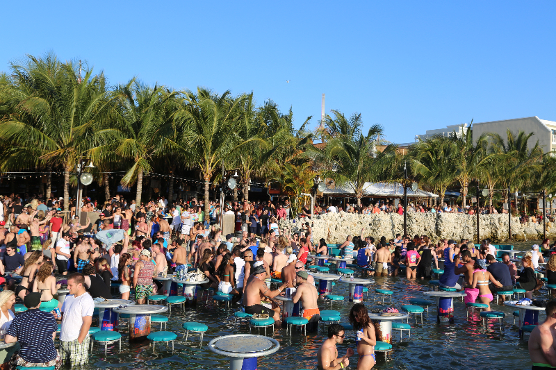 a crowd of people enjoys the sun at seacrets