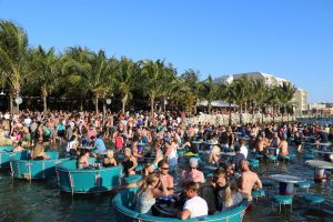people lounge seated in water