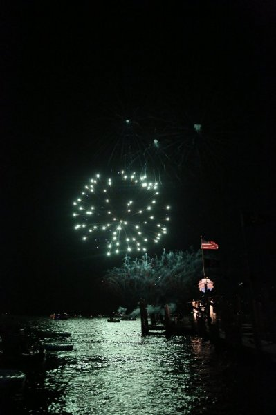 green firework explodes low at seacrets