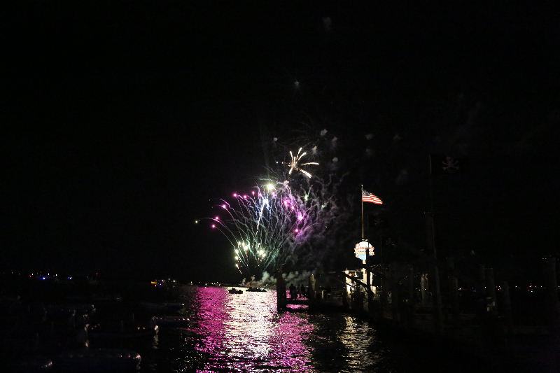 multi color fireworks over water