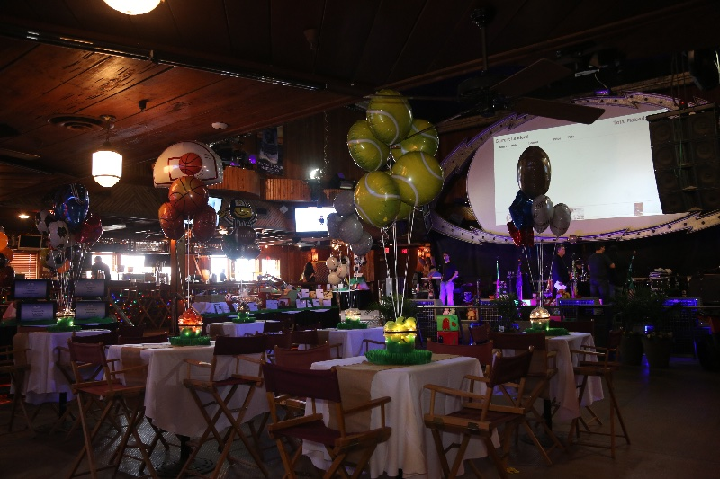 Ball shaped balloons in a restaurant for a banquet