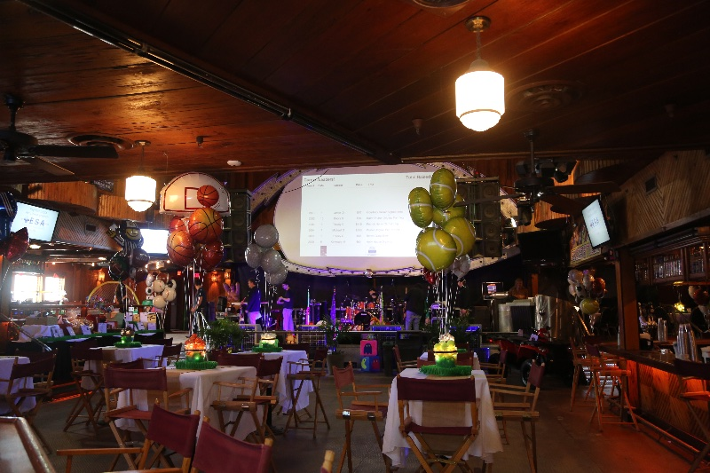 a banquet set up with projector and food tables