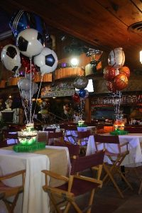 balloons above tables ready for a banquet