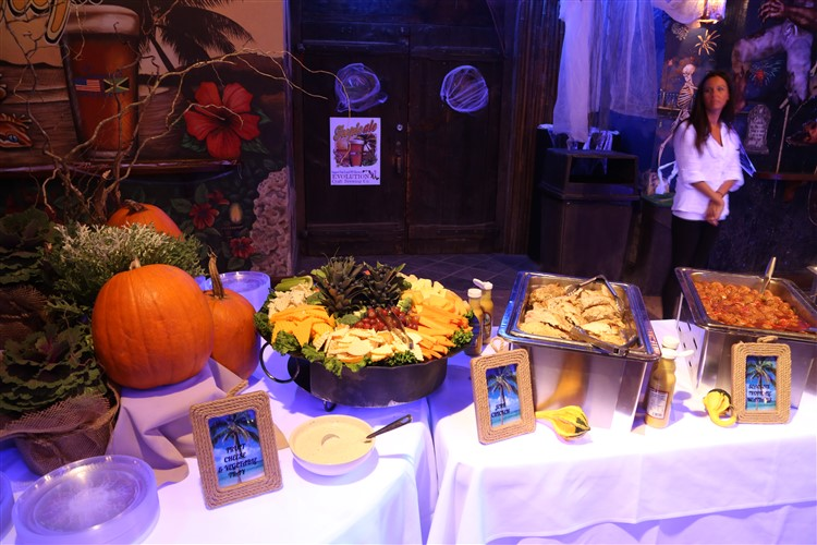 a buffet tables with pumpkin decorations
