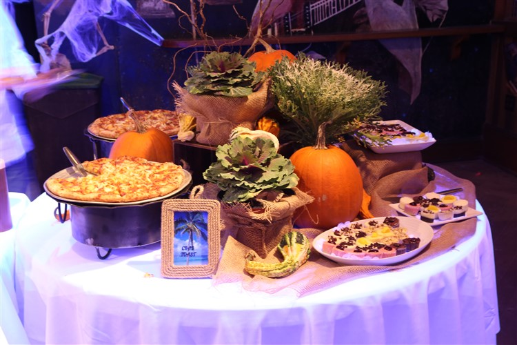 a table with autumn decorations and food examples