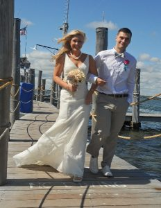 bride walks down the dock with escort