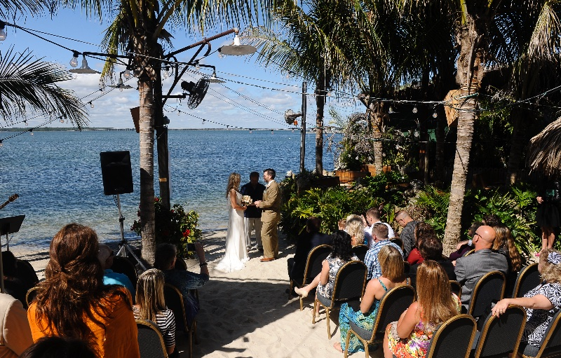 a picture of a wedding ceremony on a beach