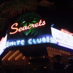 a sign in neon for seacrets nightclub