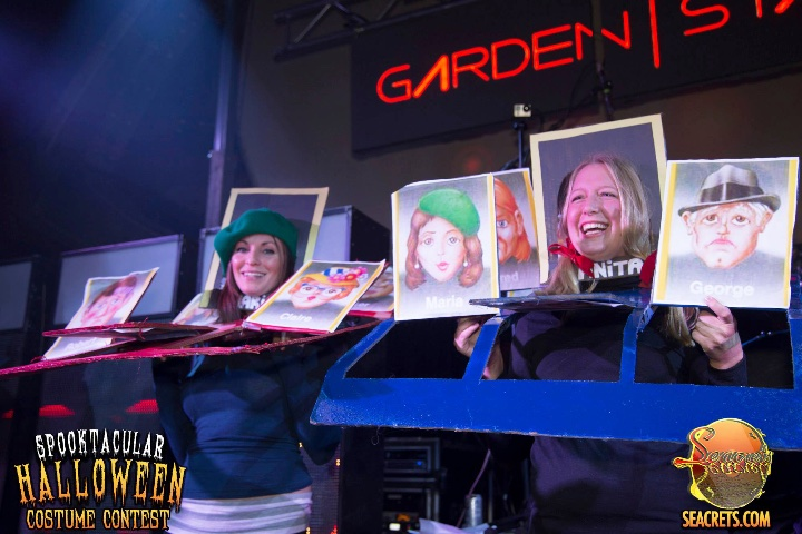 people in a guess who costume compete in contest