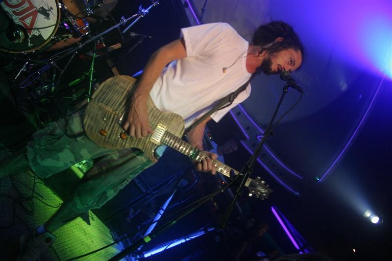 a man with dreadlocks fronts a band