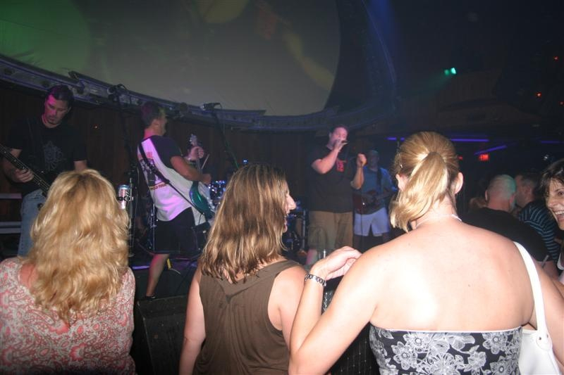 people dance to a live band on stage