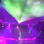the ceiling of a nightclub has space projected onto it