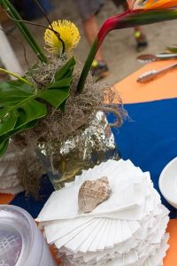 spiral napkins with a shell on top and table accents