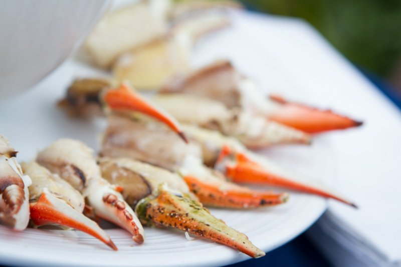 snow crab claws arranged on a plate