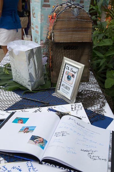 a table with signing book for a wedding