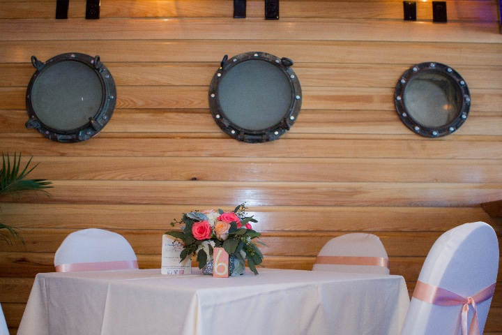a wooden plank wall with portholes