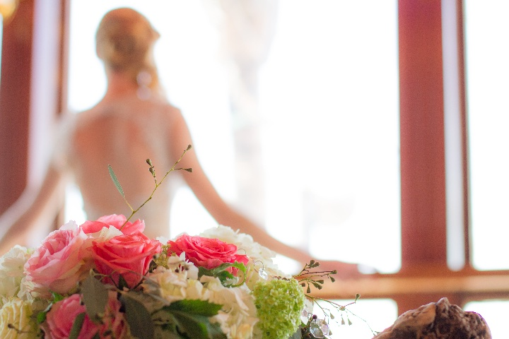 picture of flowers with bride in the background