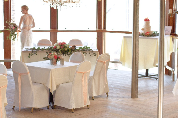 table and chairs all decorated for a wedding