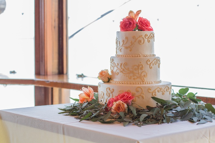 a white wedding cake with gold accents