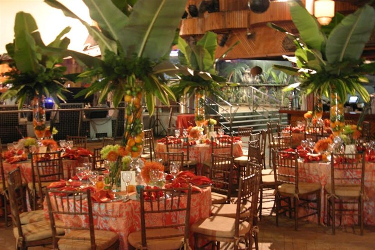 a tropical themed section of tables